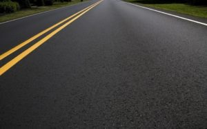 smooth paved road with double yellow line