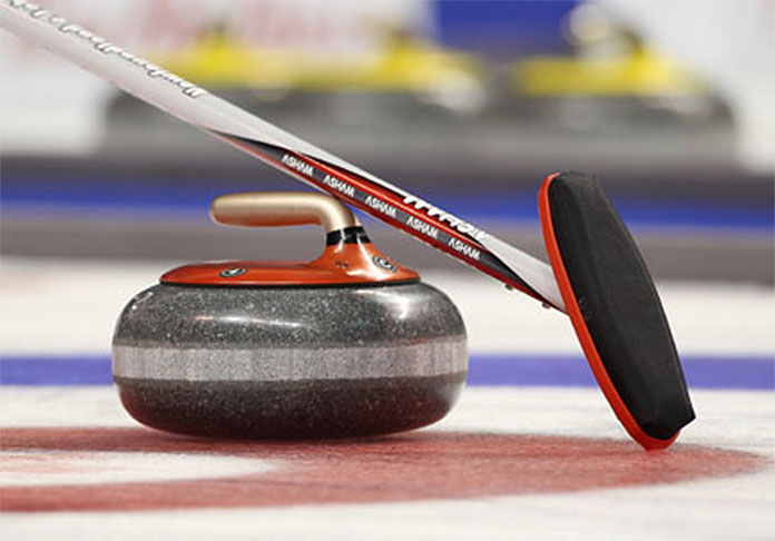 curling rock and sweeper