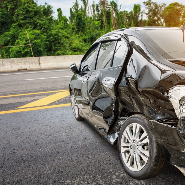black car with damage after a car accident